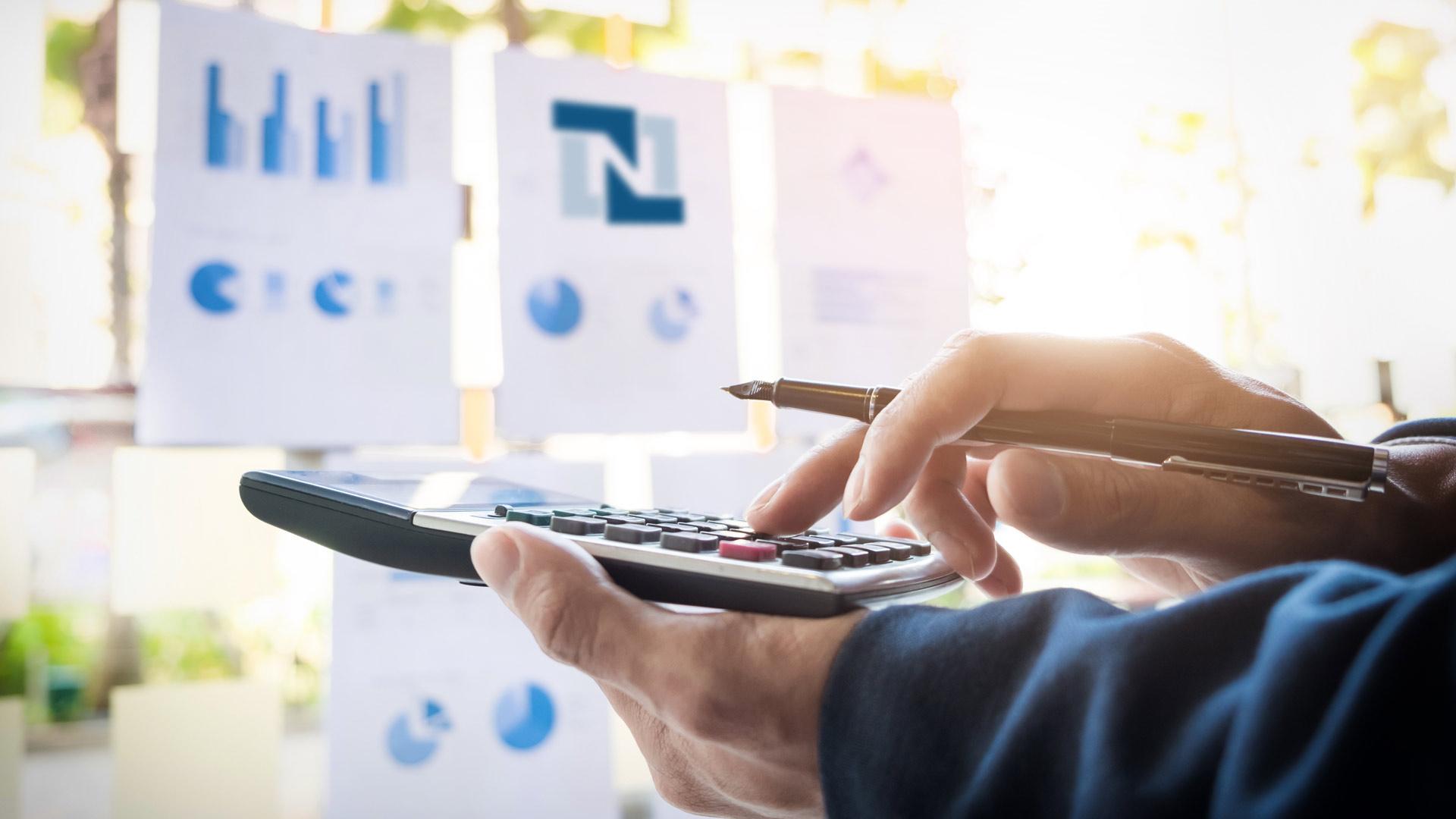 Businessman-Calculating-Invoices-Using-Calculator-netsuite.jpg