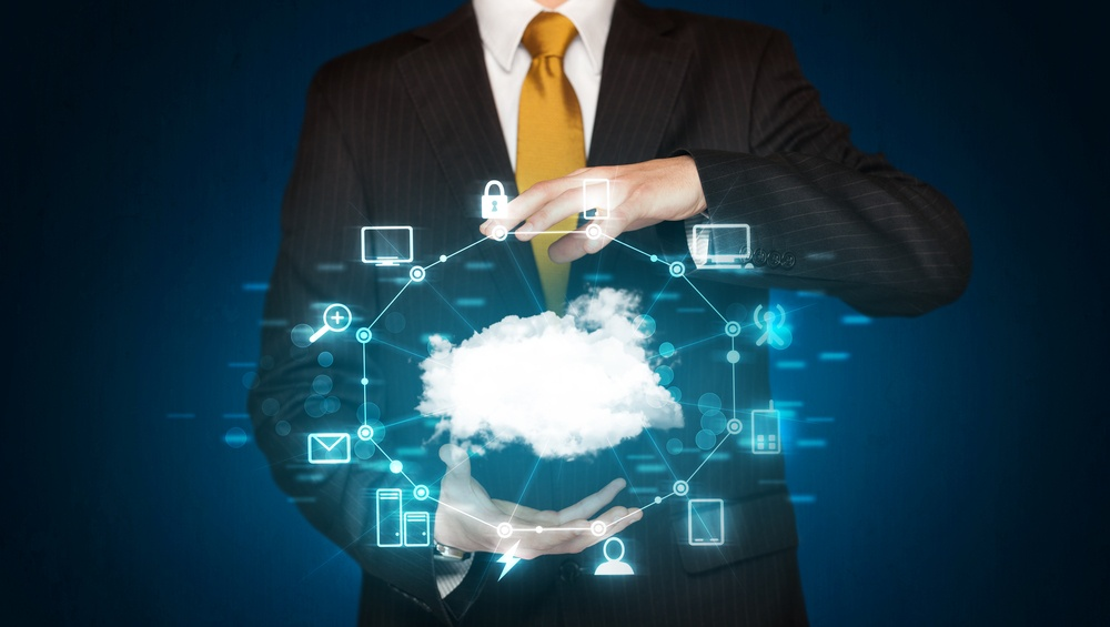 Businessman holding digital icons, Cloud computing concept.jpeg