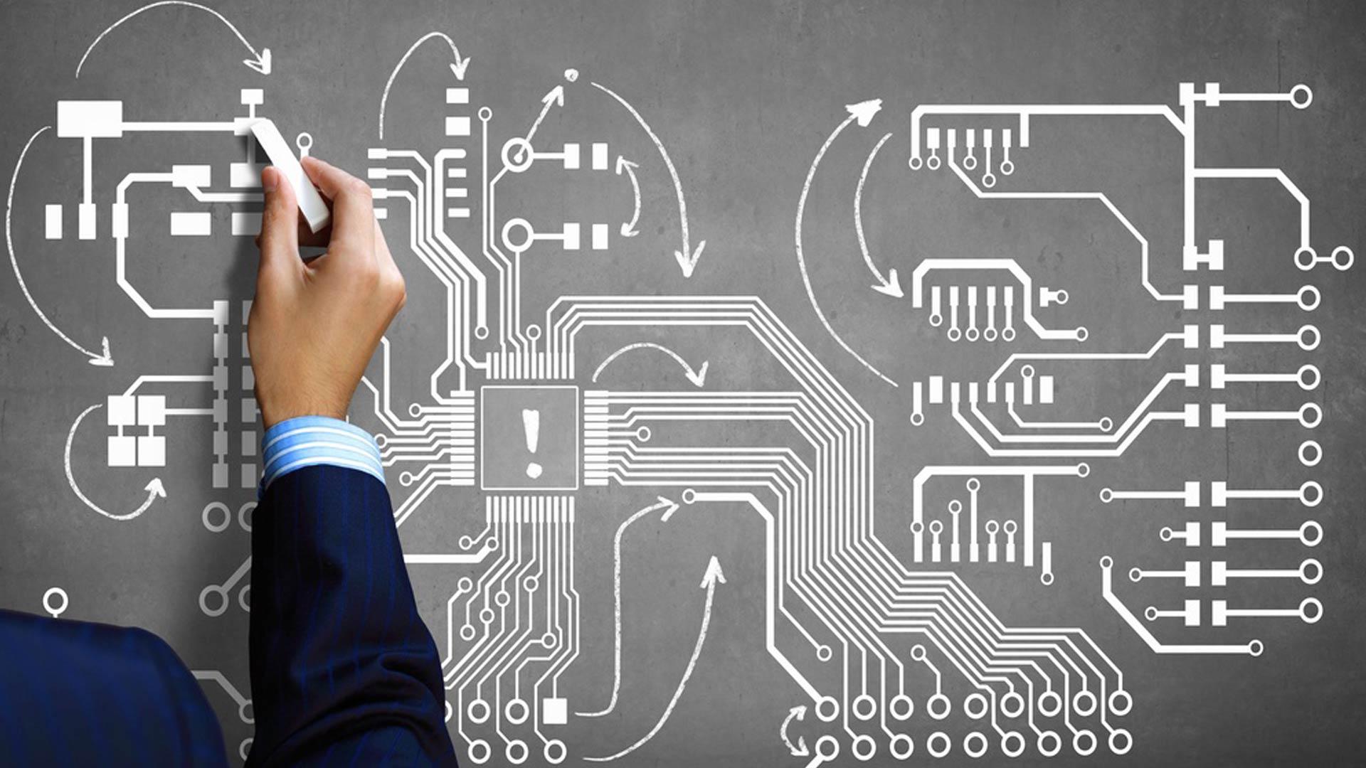 Close up image human hand drawing circuit board.jpeg