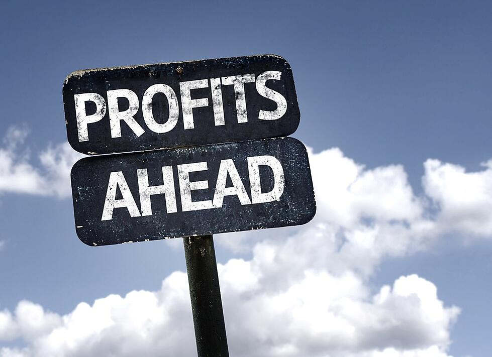 Profits Ahead sign with clouds