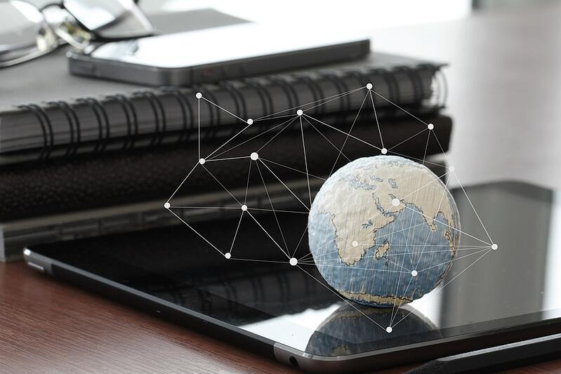 hand drawn texture globe with blank social media diagram on digital tablet computer as internet concept and bokeh exposure.jpeg