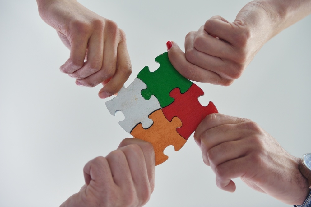 Group of business people assembling jigsaw puzzle and represent team support and help concept-1.jpeg